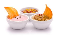 Round Chips with various Dip Sauces. Isolated on white Royalty Free Stock Photo