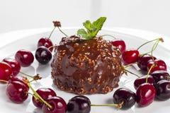 Round chocolate cake with cherries Stock Photos
