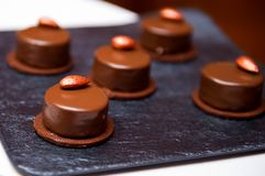 Chocolate candies on a dark surface. Selective focus