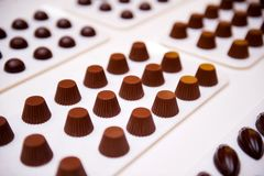 Chocolate candies on a white surface. Selective focus