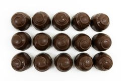 Round chocolate candy isolated on white Royalty Free Stock Images