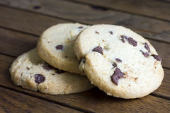 Round chocolate chip shortbread biscuits. On rustic wood. Royalty Free Stock Image
