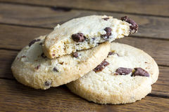Round chocolate chip shortbread biscuits. On rustic wood. Royalty Free Stock Images