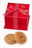 Round chocolate cookie and red gift box with bow Royalty Free Stock Photography