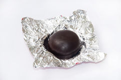 Round chocolate cookie in shiny paper Stock Photography