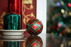 Round Christmas Candle. Colorful round christmas candles in front of Christmas tree Stock Image