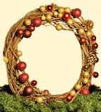 Round christmas frame. In yellow background royalty free stock photo