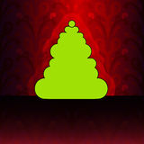 Round christmas tree on red floral pattern Royalty Free Stock Image