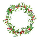 Round Christmas wreath with holly branches  on white. Royalty Free Stock Photo