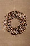 Round Christmas Wreath Natural Twigs on Old Cardboard Background Royalty Free Stock Photos