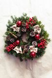 Round Christmas wreath with red baubles and berries. Closeup of home made, hand made round Christmas wreath with red baubles and berries- closeup in natural Stock Images