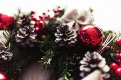 Round Christmas wreath with red baubles and berries Royalty Free Stock Photography