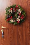 Round Christmas wreath with red baubles and berries Stock Photography