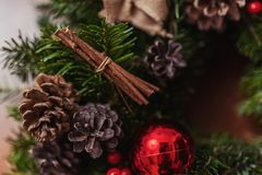 Round Christmas wreath with red baubles and berries Stock Images
