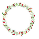 Round Christmas wreath with Santa socks isolated on white. Royalty Free Stock Photos