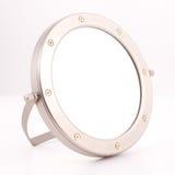 Round Chrome Mirror. Mirror for the handbag, luxury goods Royalty Free Stock Image