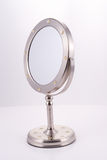 Round Chrome Mirror on Stand. Mirror for the handbag, luxury goods Royalty Free Stock Images