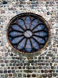 Round church window. A window in a German church, Prenzlau. Round shape, stained glass, colourful. Brick wall, gothic style Stock Images