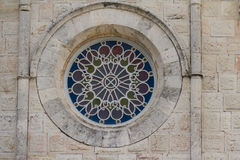 Round church window. Exterior shot of a round church window Royalty Free Stock Photos