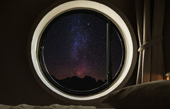 Round circle window frame with night sky full of stars with milky way Royalty Free Stock Photo