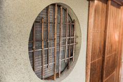 Round circle wood window japan style. Traditional home in kyoto stock photo
