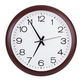 Round clock shows five minutes to seven Stock Photo