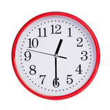 Round clock shows half of the first Royalty Free Stock Images