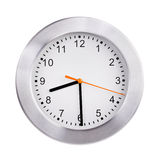 Round clock shows half of the ninth Royalty Free Stock Photography