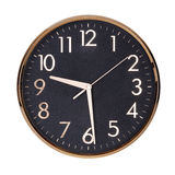 Round clock shows half past nine Royalty Free Stock Photography