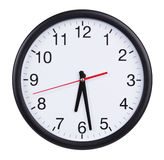 Round clock shows half of the seventh Stock Image