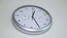 Round the clock on the wall. Wall clock in the hospital. 12:25 on the dial stock footage