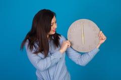 Round clock and woman Stock Photos