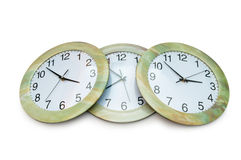 Round clocks isolated on the white Stock Photos