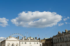 Round cloud. A beautiful cloud hanging over the London Eye Stock Photo