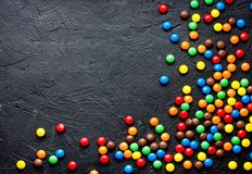 Round colorful dragee candies covered with colored chocolate