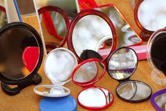 Round colorful mirrors in the shop. Round colorful mirrors over wooden table shop royalty free stock photography