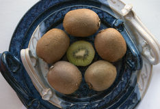 Round composition of kiwis on a decorative ceramic platter Stock Images