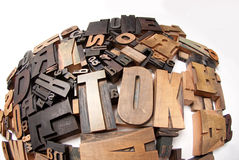 Round composition of print letter cases. Wooden typescript letters against a white background Stock Image