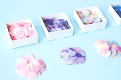 Round confetti in four square boxes royalty free stock images