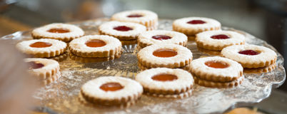 Round cookies with jam in a crystal vase Stock Images