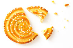 Round Cookies with sesame seeds with  bite on white Royalty Free Stock Image