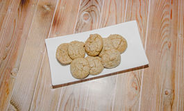 Round cookies stack on a white plate, powder sugar Royalty Free Stock Photography