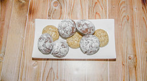 Round cookies stack on a white plate, powder sugar Stock Photo