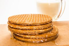 Round cookies or wafers with a layer of caramel lies on a rough stock photo