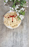 Round cookies on wooden table. Apple blossom Royalty Free Stock Image