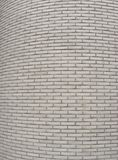 Round corner of a large white tiled wall Royalty Free Stock Photo