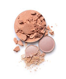 Round crashed beige face powder and nude color eyeshadow for makeup as sample of cosmetics product. Round crashed beige face powder and nude colour eyeshadow for stock image