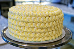 Round creamy cake on the bakery storefront Stock Image