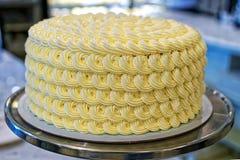 Round creamy cake on the bakery storefront Stock Image