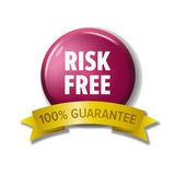 Round crimson button with words `Risk Free - 100% Guarantee`. Round crimson button and golden ribbon with words `Risk Free - 100% Guarantee`. Bright label for Royalty Free Stock Photos